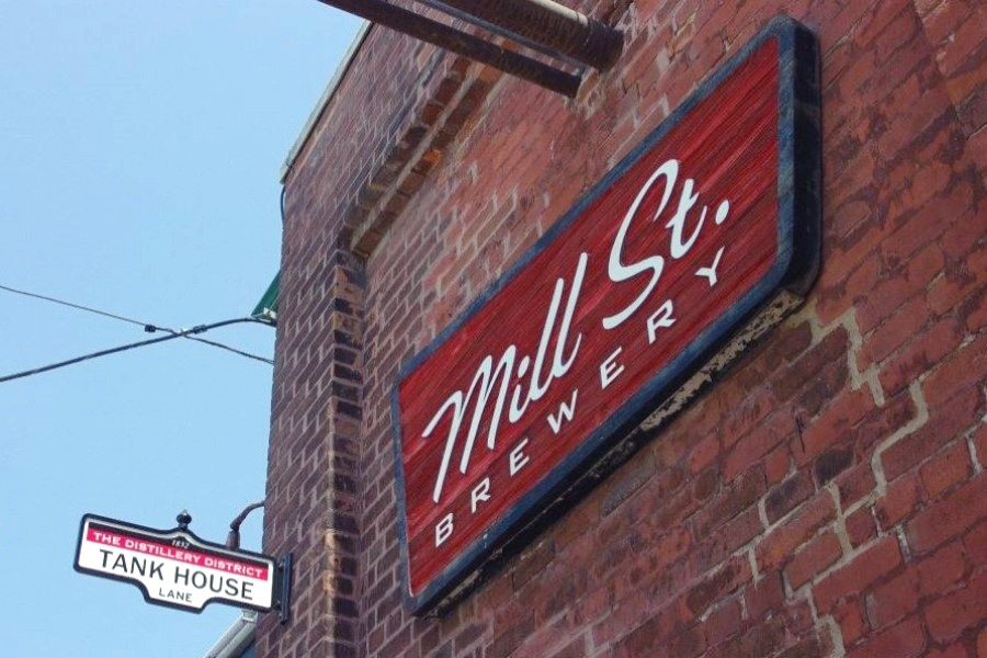 A sign of Mill Street Brew Pub on the building